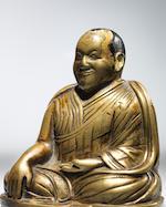 A BRASS ALLOY FIGURE OF LAMA SHANG TIBET, CIRCA 13TH CENTURY