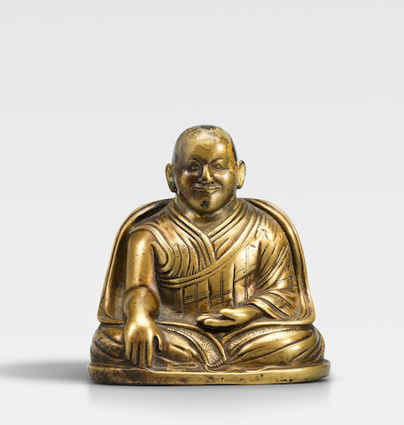 A BRASS ALLOY FIGURE OF LAMA SHANG TIBET, CIRCA 13TH CENTURY
