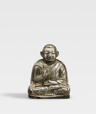 A SILVER FIGURE OF A KAGYU LAMA TIBET, CIRCA 13TH CENTURY