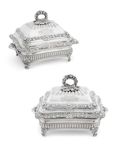A pair of Important Regency  sterling silver  covered entrée dishes on Sheffield plated stands from the Foley service by Benjamin Smith III, London,  1819
