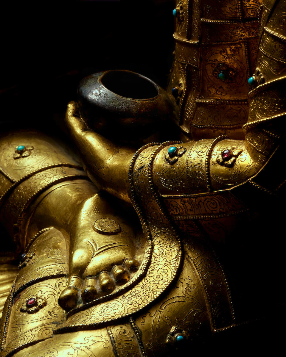 A GILT COPPER ALLOY FIGURE OF AKSHOBHYA TIBET, 15TH CENTURY