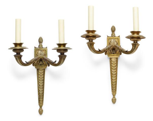 A pair of Louis XVI style gilt bronze two light bras de lumière 20th century