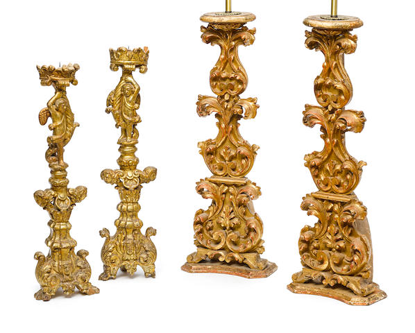 Two pairs of Italian Baroque style carved giltwood prickets 19th century