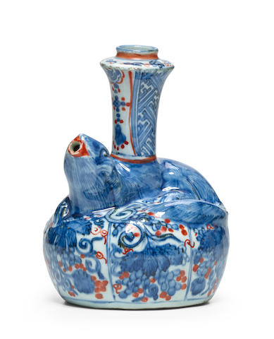A rare squirrel-form underglaze blue and iron-red porcelain kendi Ming dynasty, Wanli period