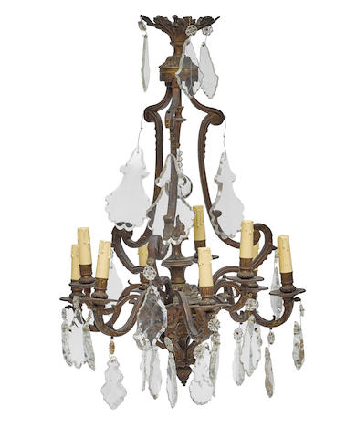 A Baroque style patinated bronze nine light chandelier 20th century