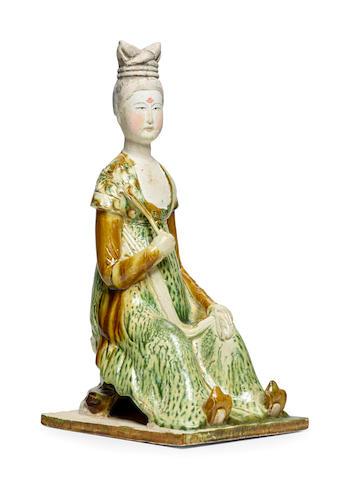 A RARE SANCAI-GLAZED POTTERY FIGURE OF A COURT LADY Tang dynasty