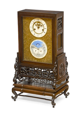 A chinese carved hardwood calendar clock 20th century