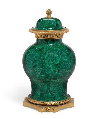 A Louis XVI style gilt bronze mounted malachite veneered covered vase 20th century