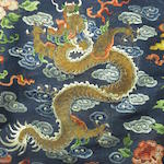 An embroidered blue silk gauze dragon robe Late Qing dynasty