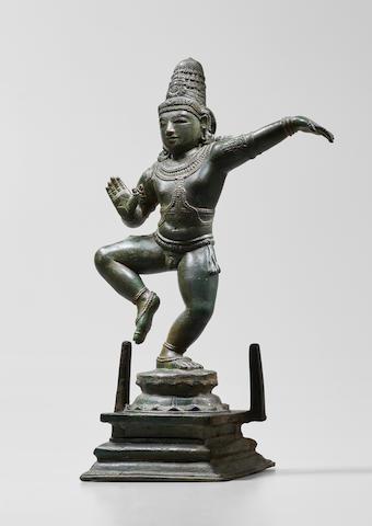 A COPPER ALLOY FIGURE OF KRISHNA DANCING TAMIL NADU, CHOLA DYNASTY, CIRCA 12TH CENTURY