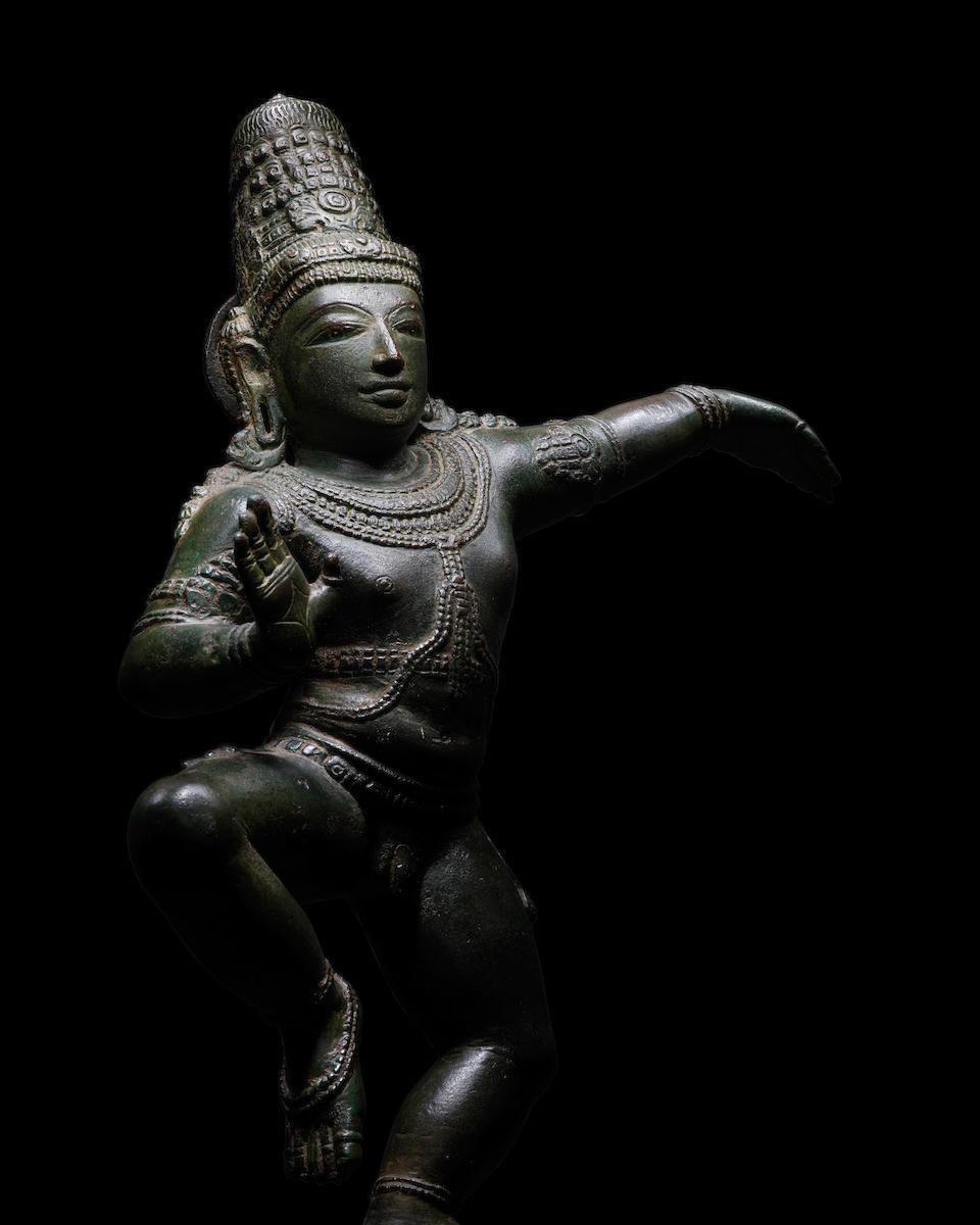 A COPPER ALLOY FIGURE OF DANCING KRISHNA TAMIL NADU, CHOLA DYNASTY, CIRCA 12TH CENTURY