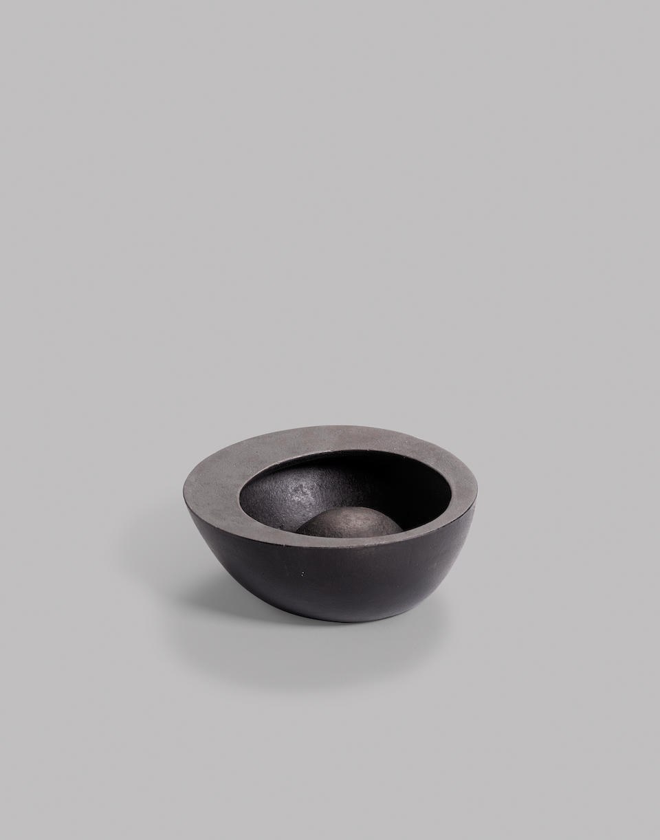 Attributed to Isamu Noguchi (1904-1988) Rare Bowlby OOI KOJO for Bonniers designed circa 1944-48, executed 1950spatinated iron stamped 'Bonniers Japan'height 2 5/8in (6cm); diameter 6 3/4in (17cm)
