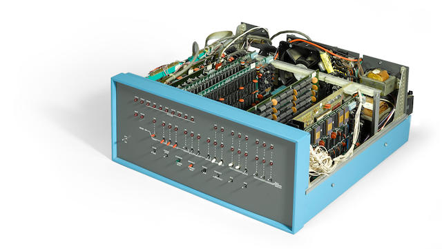 ALTAIR 8800 8-Bit Microcomputer by MITS, c.1974, aluminum case with removable top, face panel with 36 LEDs, 25 switches, cooling fan, additional power supply and interface cables at back, containing 9 modules: