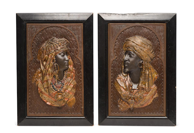 A pair of cold painted cast metal relief portrait panels first half 20th century