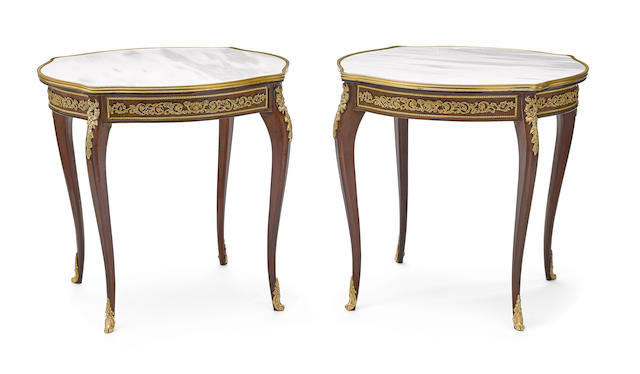 A pair of Louis XV style gilt bronze mounted mixed wood salon tables