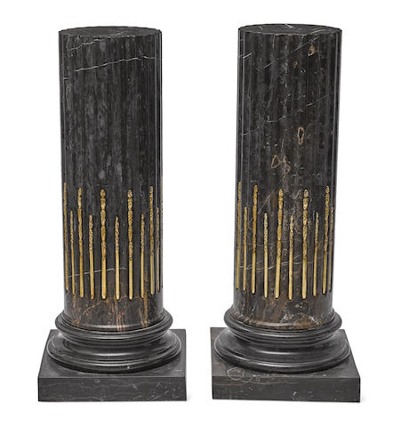 A pair of Neoclassical style gilt bronze mounted marble pedestals