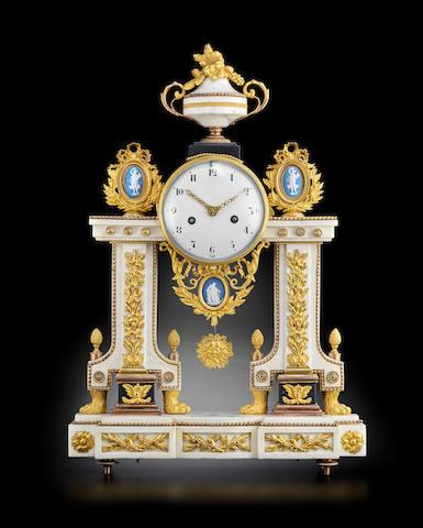 A late Louis XVI ormolu and porcelain mounted white marble mantel clockcirca 1790