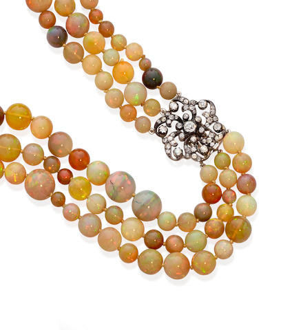 An Opal bead, diamond and blackened gold triple strand necklace