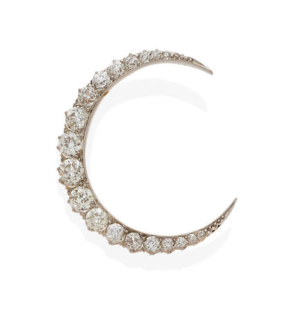 A diamond and platinum-topped gold crescent brooch,