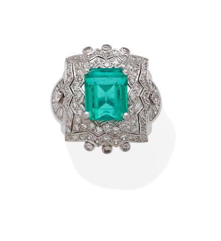 An emerald, diamond and platinum ring