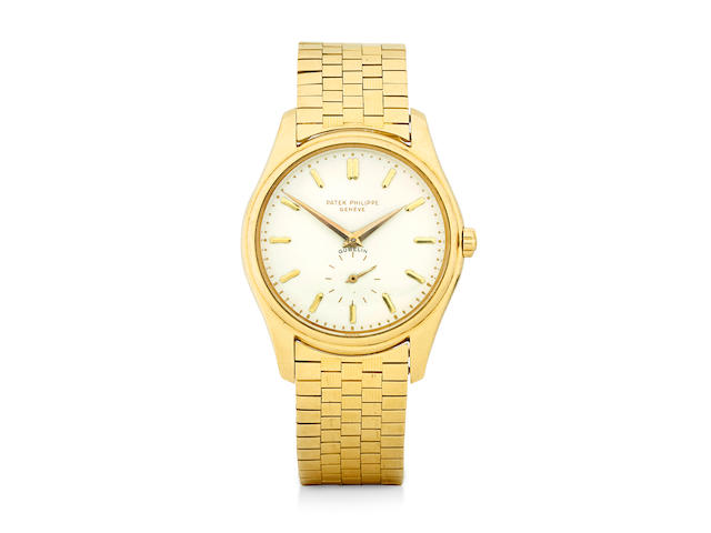 Patek Philippe. A very fine and rare 18K gold first execution enamel dial wristwatch with braceletRetailed by Gübelin Ref: 2526, sold November 9, 1956