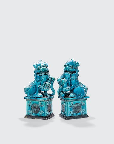 a pair of turquoise glazed fu-lions and stands Qing dynasty