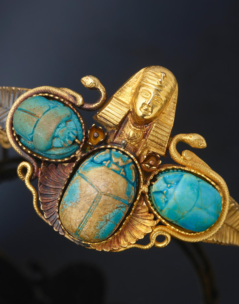 A collection of scarab and gold jewelry