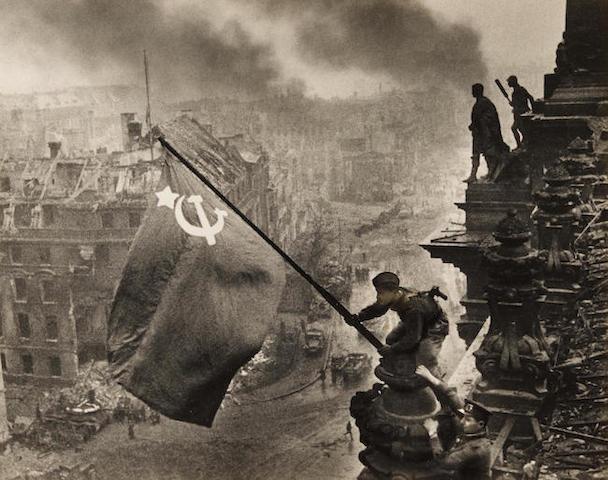 KHALDEI, YEVGENI. 1917-1997. Original photograph, Berlin. Znamya Pobedy nad reikhstagom [Banner over the Reichstag in Berlin], 1945,