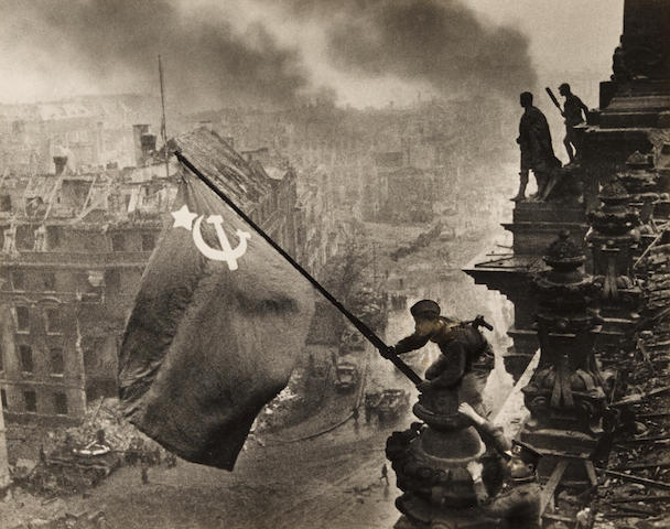 KHALDEI, YEVGENI. 1917-1997. Original photograph, Berlin. Znamya Pobedy nad reikhstagom [Banner over the Reichstag in Berlin], 1945,