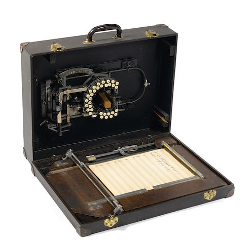 """Keaton Music Typewriter 33-key model, c.1953, with circular matrix and detachable wooden rack base, with  """"Keaton Music Typewriter / Patent Pending  ...  San Francisco, U.S.A.""""  plaque,"""