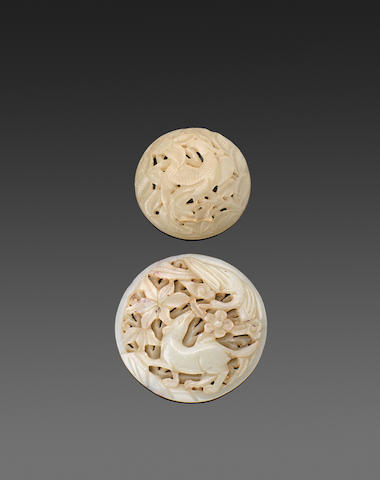 Two reticulated jade circular plaques