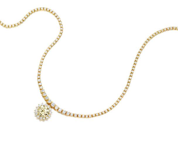 A fancy colored diamond and diamond pendant necklace