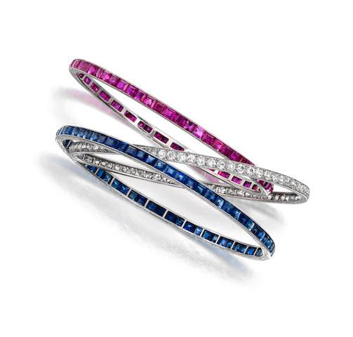 A trio of diamond, sapphire and ruby bangle bracelets