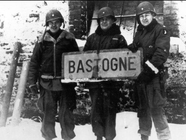 """Siege of Bastogne: """"bastogne"""" village sign. Belgian, 1944."""