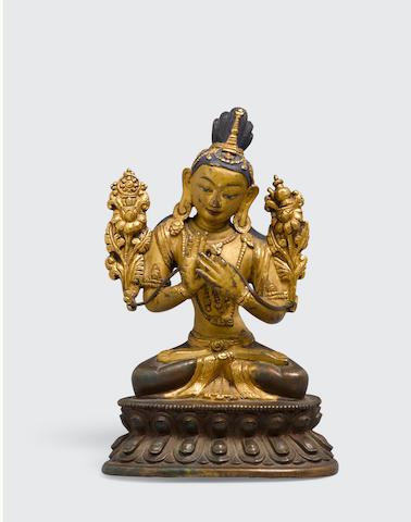 A gilt copper alloy figure of Maitreya Tibet, 19th century