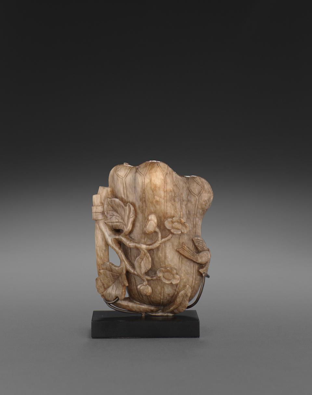 A fine lotus leaf form jade vase 17th century