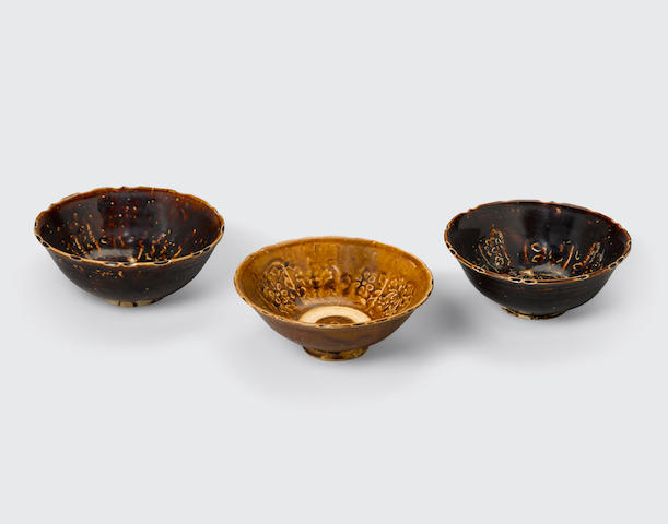 A group of three brown glazed bowls with impressed decoration Tran-Le dynasties, 14th/15th century