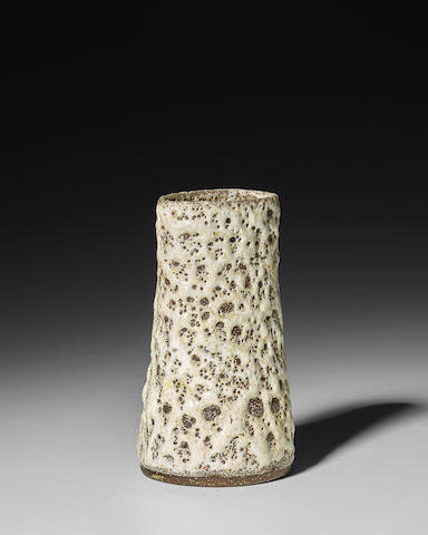 Lucie Rie (1902-1995)  Pot with Oval Lipcirca 1972stoneware with white pitted and flowing glaze, impressed designer's monogram 'LR'height 4 3/4in (12cm); width at widest point 2 1/2in (6.4cm)