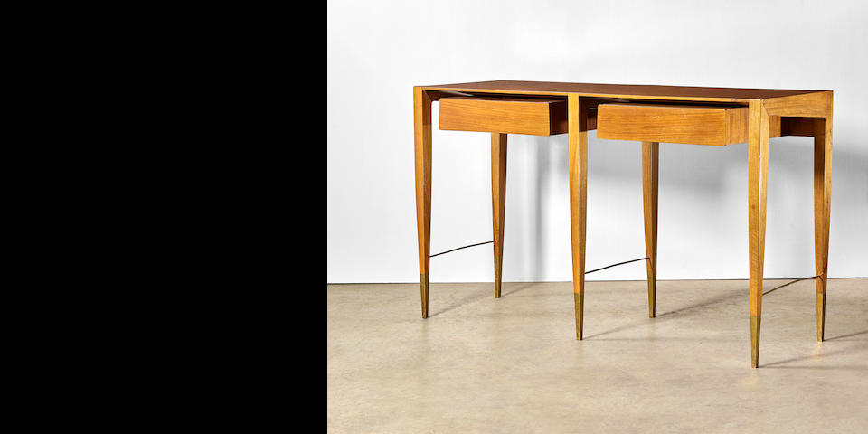 Gio Ponti (1891-1979) Console tablefor Giordano Chiesa, Milan, circa 1950walnut, brass sabots; together with a certificate of authenticity from the Gio Ponti Archivesheight 35in (88cm); width 60in (152cm); depth 19 3/4in (50cm)