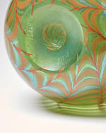 Tiffany Studios (1899-1919) Special Order Vasecirca 1901decorated Favrile glass, engraved 'L.T.C o7371'height 9 1/2in (24cm); diameter at widest point 4 1/2in (11.5cm)