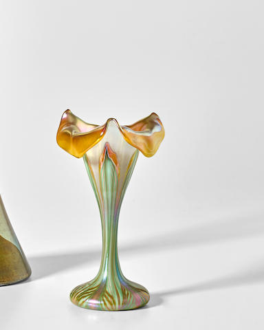 Quezal (1901-1924) Floriform Vasecirca 1910decorated iridescent glass with pulled feather motif, engraved 'Quezal S L51'height 5 3/4in (14.5cm)l width 3 1/4in (8cm)