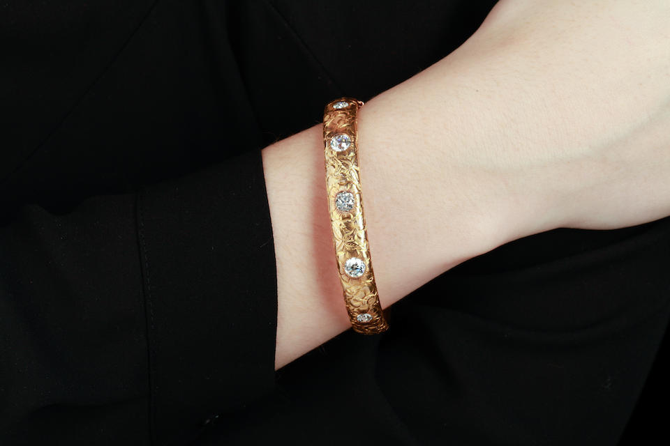 A diamond and 14k gold bangle bracelet, Kohn