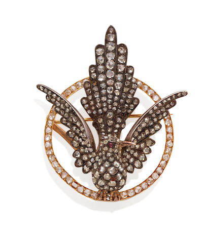A diamond, ruby, silver and gold brooch