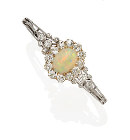 An opal, diamond and 18k gold bangle bracelet