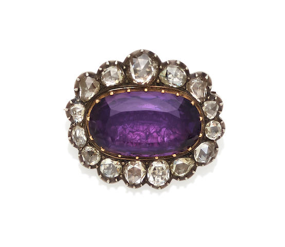 An amethyst, diamond and silver-topped gold brooch,