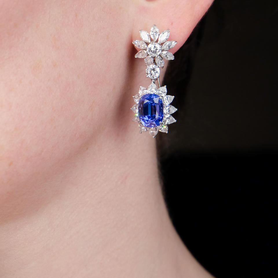 A pair of sapphire and diamond day/night earrings