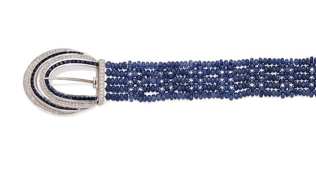A tanzanite, diamond, sapphire and 18k white gold buckle bracelet