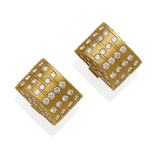 A pair of diamond and gold cufflinks