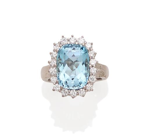 A blue topaz, diamond and 14k white gold ring