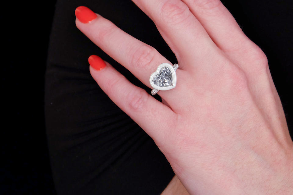 A fancy colored diamond, diamond and ceramic ring